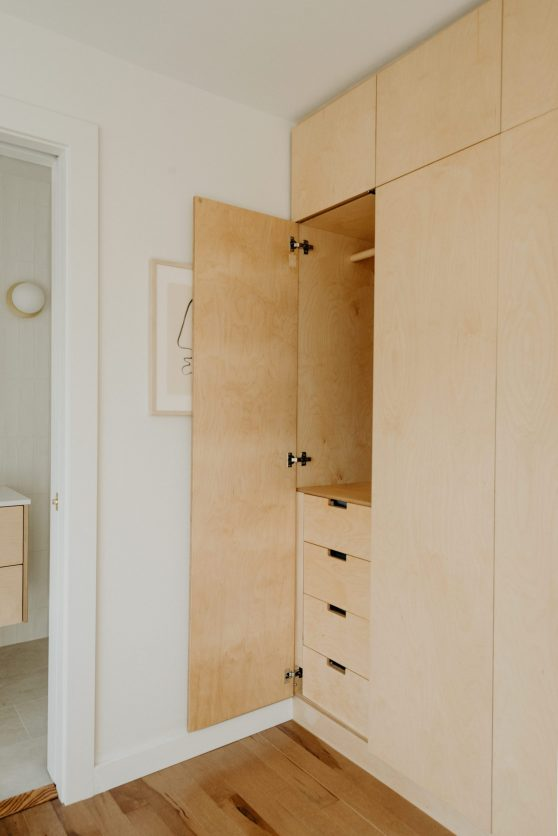 Built-in minimalist wood closet cabinet details